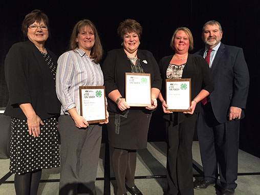 MFB recognizes the 2017 4-H Excellence in Agriculture Award recipients at MFB Voice of Agriculture Conference. Left to right: Cathy McCune, Chair of MFB State Promotion & Education Committee, award recipients: Michelle Barnes, Melanie Barnes, Tiffany Spedowski and MFB President Carl Bednarski.