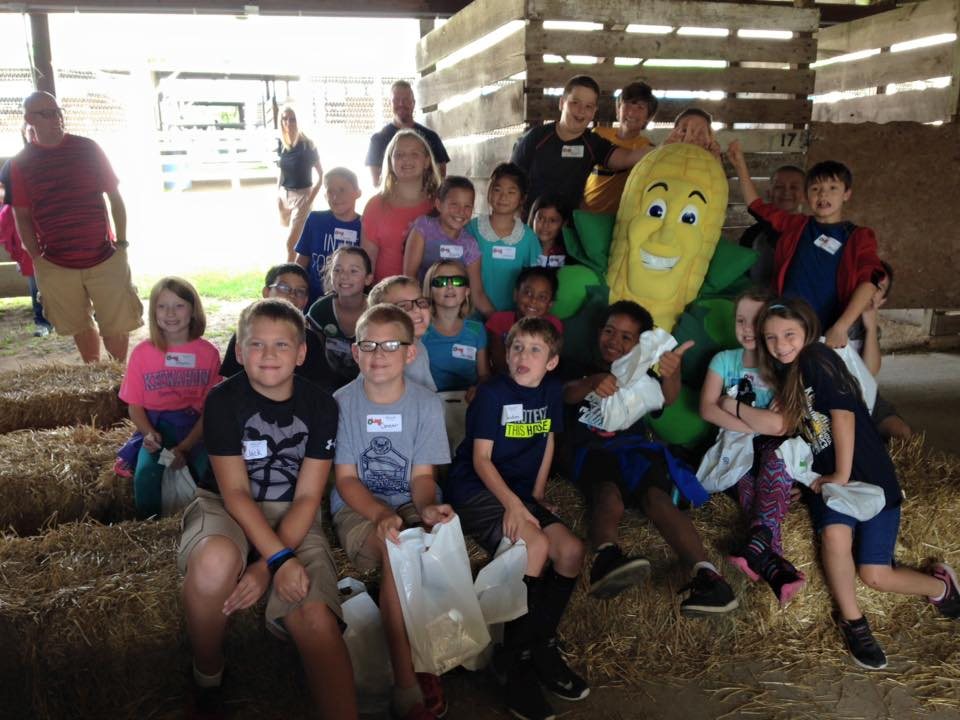 The Corn Marketing Program works to grow the corn industry in Michigan including promotion, education and research that stimulates the demand for corn. Above is Captain Cornelius, the CMP mascot with youth from St. Clair County.