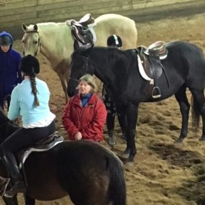 Eleanor Miller, Leelanau County 4-H volunteer, teaches youth about horseback riding.