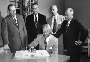 George A. Haggarty, Detroit attorney and first president of the Michigan 4-H Foundation, signs the scroll on May 27, 1952, as other incorporators look on. They are (L to R): Joseph C. Cahill, Detroit Edison Company; Milon Grinnell, editor of Michigan Farmer and vice president of the foundation; H.J. Gallagher, Consumers Power Company; and Arne G. Kettunen, state 4-H club leader and secretary of the foundation. Joseph H. Alexanian was the sixth incorporator (not pictured).